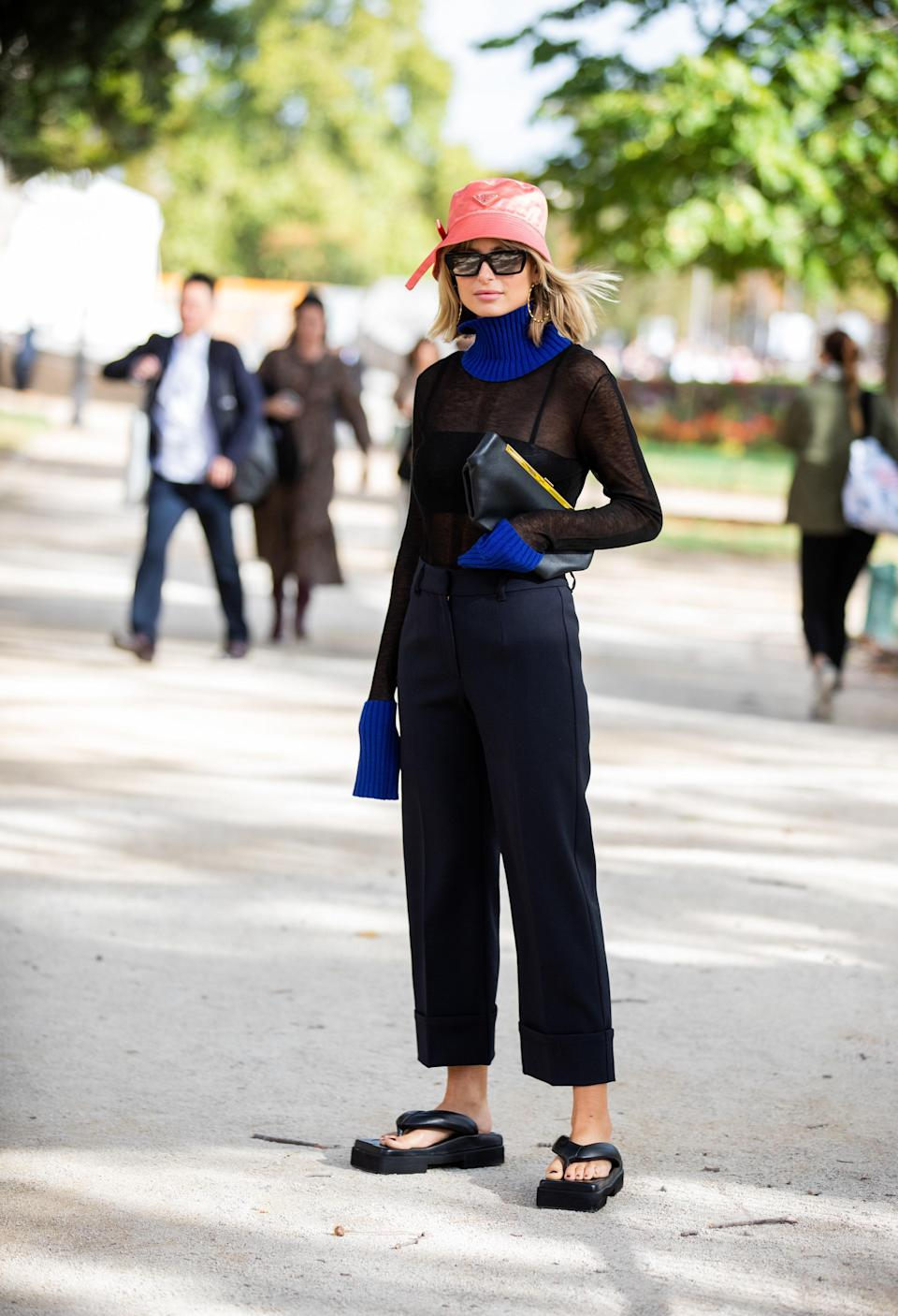 "<a href=""https://www.glamour.com/gallery/best-katie-holmes-fall-outfits?mbid=synd_yahoo_rss"" rel=""nofollow noopener"" target=""_blank"" data-ylk=""slk:Katie Holmes"" class=""link rapid-noclick-resp"">Katie Holmes</a>, Kendall Jenner, Hailey Bieber, and Rihanna have all gotten behind the notorious thong sandal—favoring leather kitten heel styles the most. The throwback shoe looks surprisingly chic when worn with jeans, dresses, or your next beach <em>lewk.</em>"