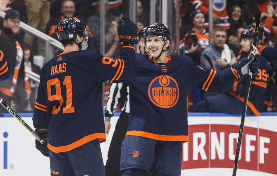 Edmonton Oilers' Gaetan Haas (91) celebrates his goal with Matt Benning (83) during the second period of an NHL hockey game against the New Jersey Devils on Friday, Nov. 8, 2019, in Edmonton, Alberta. (Jason Franson/The Canadian Press via AP)