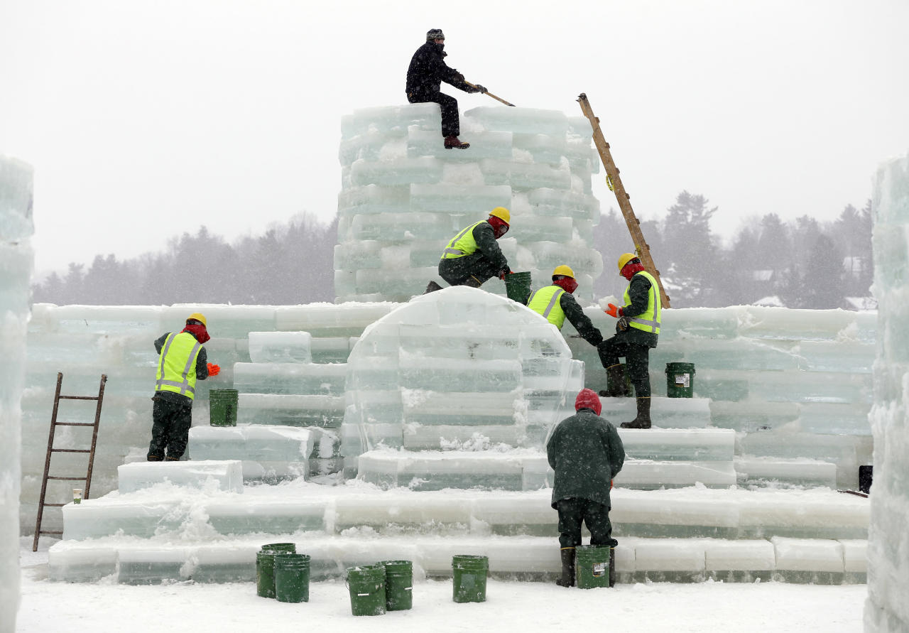 Volunteer Jeff Branch, top, and inmates from the Moriah Shock Incarceration Correctional Facility, work on the Saranac Lake Winter Carnival ice palace on Monday, Jan. 28, 2013, in Saranac Lake, N.Y. (AP Photo/Mike Groll)