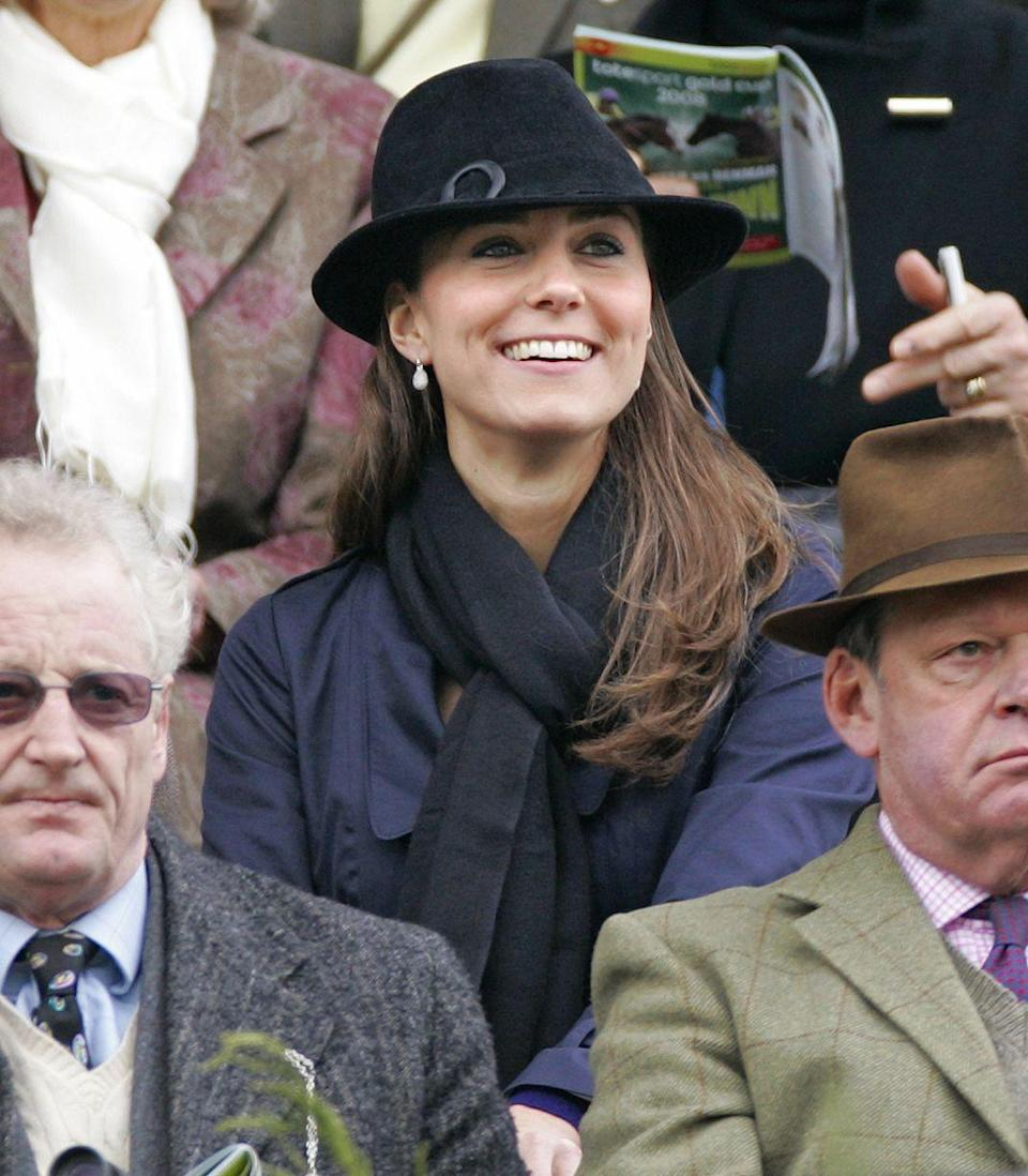 <p>Middleton beamed during the Cheltenham Horse Racing Festival. By this time, rumors had arisen that her and Prince William were back on.</p>