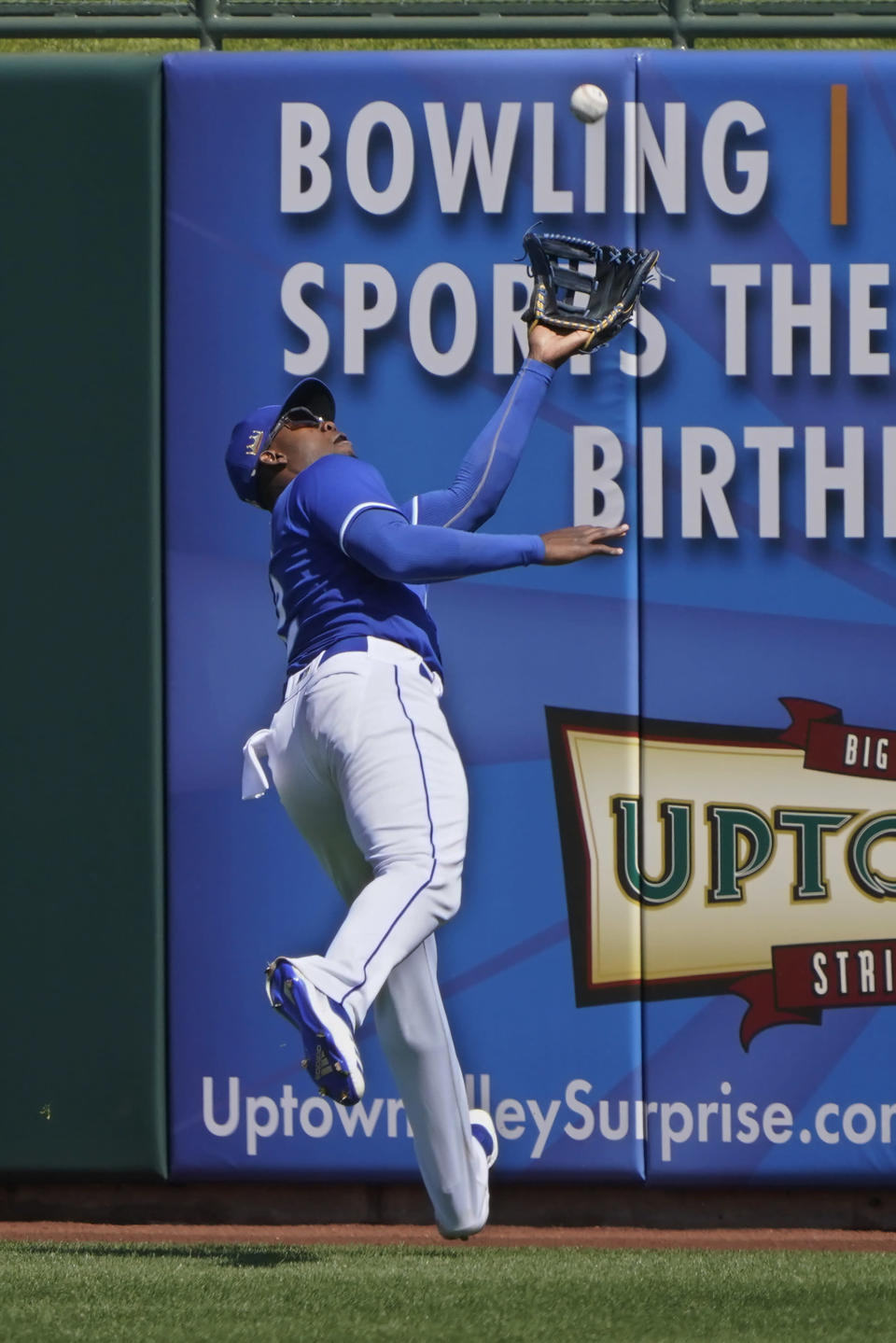 Kansas City Royals right fielder Jorge Soler catches a fly ball hit by Colorado Rockies' Raimel Tapia for an out in the third inning of a spring training baseball game Sunday, March 21, 2021, in Surprise, Ariz. (AP Photo/Sue Ogrocki)