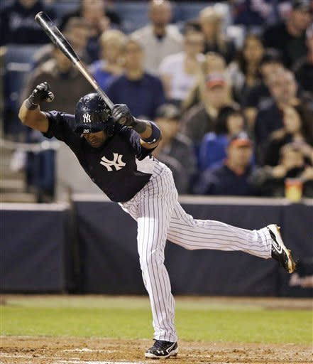 New York Yankees' Eduardo Nunez leaps to dodge an inside pitch from Atlanta Braves' Paul Maholm during the first inning of a spring training exhibition baseball game, Tuesday, March 5, 2013, in Tampa, Fla. (AP Photo/Matt Slocum)