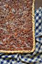 """<p>Bring the comforts of a classic pecan pie together with the ease of a slab pie, and you have a divine creation. Serve warm with homemade whipped cream.</p><p><strong><a href=""""https://www.countryliving.com/food-drinks/a29145983/nancy-fuller-pecan-slab-pie/"""" rel=""""nofollow noopener"""" target=""""_blank"""" data-ylk=""""slk:Get the recipe"""" class=""""link rapid-noclick-resp"""">Get the recipe</a>.</strong> </p>"""