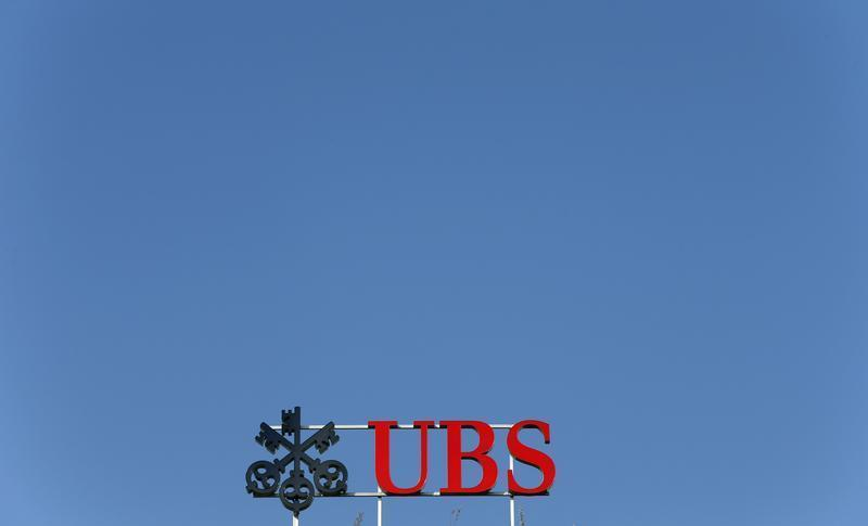 The logo of Swiss bank UBS is seen on an office building in Zurich