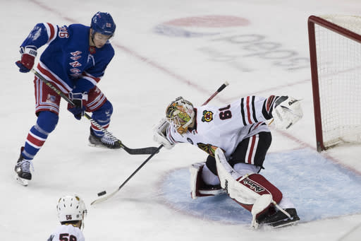 Chicago Blackhawks goaltender Collin Delia (60) makes a save against New York Rangers left wing Jimmy Vesey (26) during the third period of an NHL hockey game Thursday, Jan. 17, 2019, at Madison Square Garden in New York. The Rangers won 4-3. (AP Photo/Mary Altaffer)