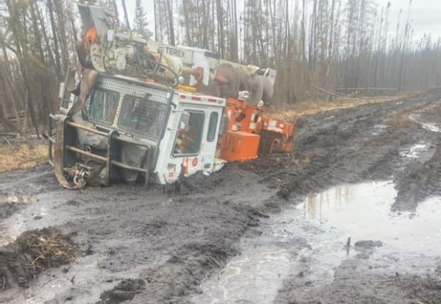 Many of the giant track machines SaskPower uses to get people and equipment into the wildfire-affected area got stuck in boggy conditions Thursday.