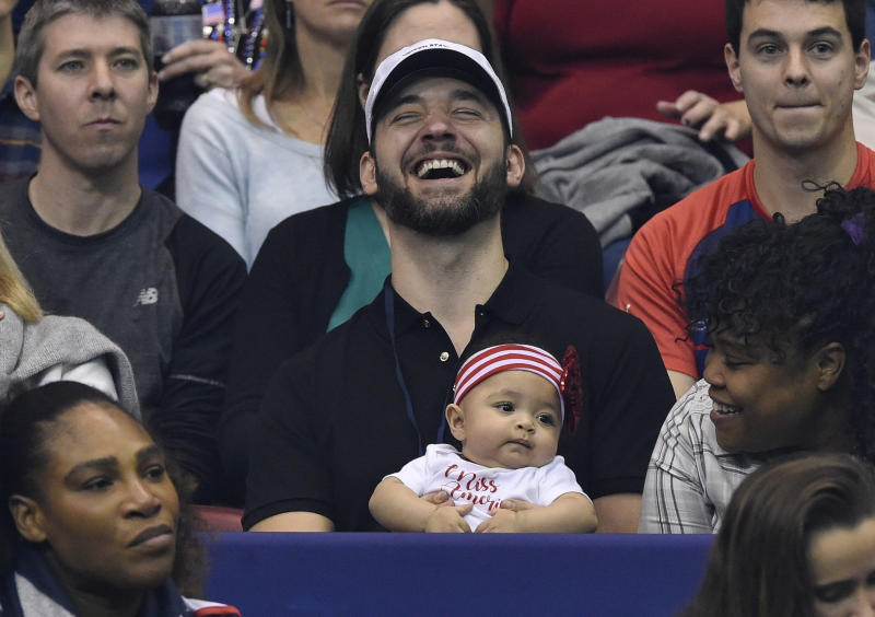 ASHEVILLE, NC - FEBRUARY 10: Serena Williams of Team USA, bottom left, along with her husband Alexis Ohanian and their daughter Alexis Olympia, center, watch the action during the first round of the 2018 Fed Cup at US Cellular Center on February 10, 2018 in Asheville, North Carolina. (Photo by Richard Shiro/Getty Images) (Getty Images)
