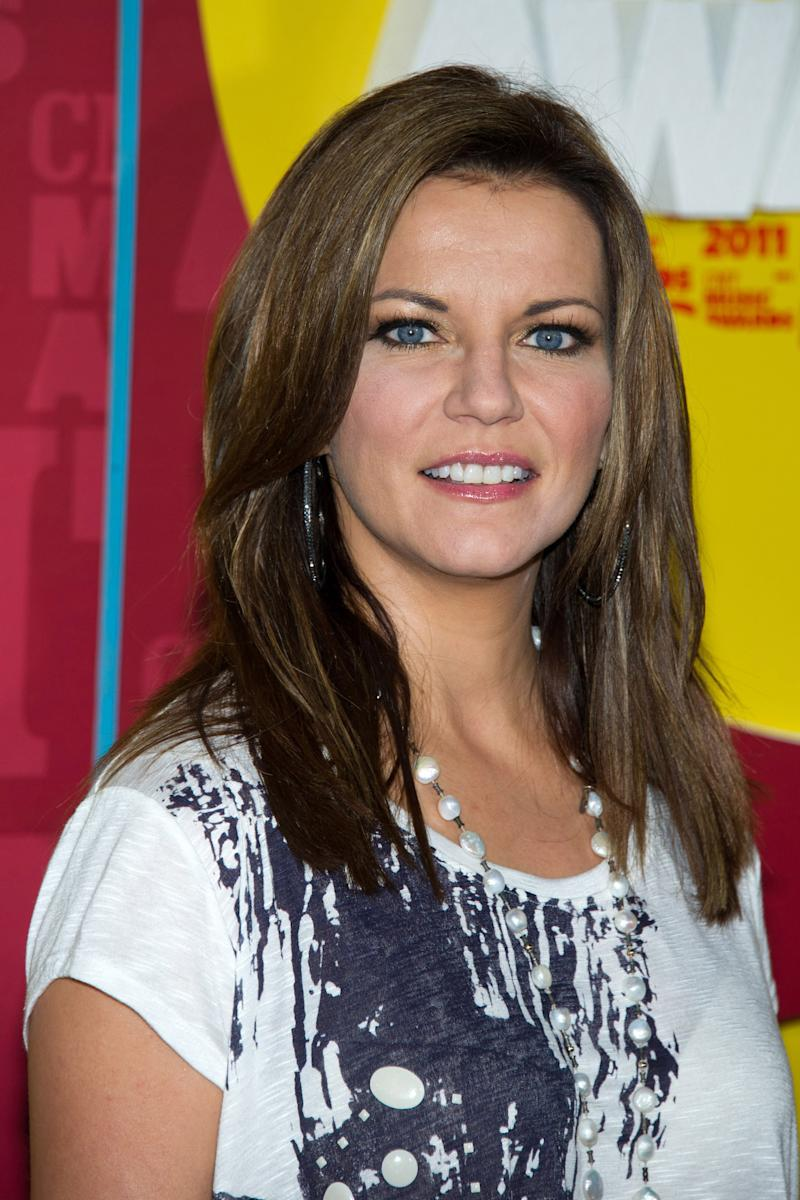 """FILE - In this June 8, 2011 file photo, Martina McBride arrives at the 2011 CMT Music Awards in Nashville, Tenn. McBride is releasing her new album, """"Eleven,"""" in  October with a cross-country train ride from Los Angeles to New York.  (AP Photo/Charles Sykes, file)"""