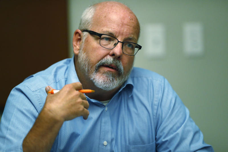FILE - In this Sept. 20, 2019, file photo, state Rep. Tom Sullivan, D-Aurora, who lost his son Alex in the 2012 movie theatre massacre in Aurora, Colo., speaks during a roundtable discussion about the issues of gun control and the need for additional mental health measures with several survivors of mass shooting victims at an office in downtown Denver. Sullivan is opposing a death penalty repeal bill before Colorado lawmakers Wednesday, Feb. 26, 2020. (AP Photo/David Zalubowski, File)