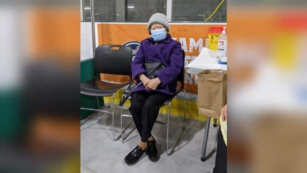 Betty Ing was the first person to enter the WFCU Centre on vaccination day, and was one of the first to receive the shot, according to WECHU.