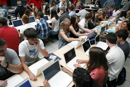 Students set up their donated laptop computers on the first day of school at Joplin High School in Joplin