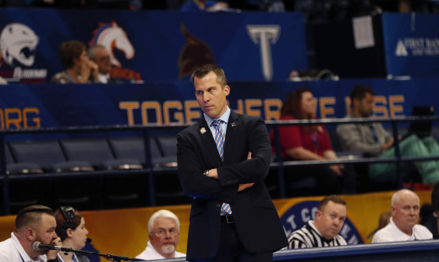 Texas-Arlington head coach Scott Cross watches from the bench in the first half of the the Sun Belt Conference NCAA college basketball championship game against Texas-Arlington in New Orleans, Sunday, March 11, 2018. (AP Photo/Gerald Herbert)