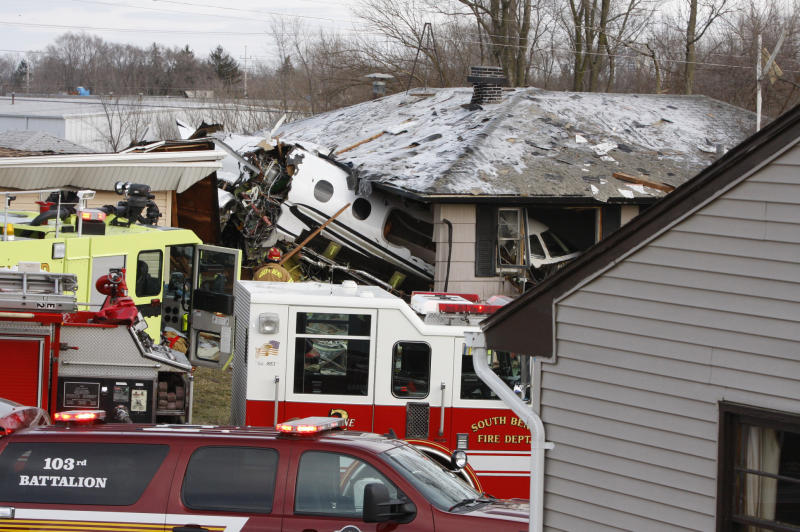 The front end of a Hawker Beachcraft Premier jet sits in a room of a home on Iowa Street in South Bend, Ind., Sunday, March 17, 2013. Authorities say a private jet apparently experiencing mechanical trouble crashed resulting in injuries. Federal Aviation Administration spokesman Roland Herwig says the Beechcraft Premier I twin-jet had left Tulsa, Okla.'s Riverside Airport and crashed near the South Bend Regional Airport on Sunday afternoon. (AP Photo/South Bend Tribune, Mike Hartman)