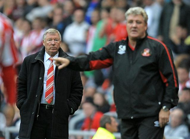 Manchester United's Scottish manager Sir Alex Ferguson (L) and Sunderland's English manager Steve Bruce look on during the English Premier League football match between Sunderland and Manchester United at the Stadium of Light, Sunderland, north-east England, on October 2, 2010. AFP PHOTO/ANDREW YATES FOR EDITORIAL USE ONLY Additional licence required for any commercial/promotional use or use on TV or internet (except identical online version of newspaper) of Premier League/Football League photos. Tel DataCo +44 207 2981656. Do not alter/modify photo. (Photo credit should read ANDREW YATES/AFP/Getty Images)