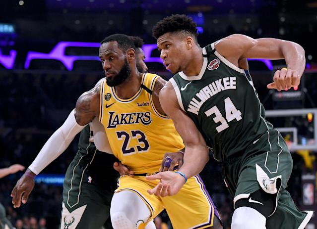 """<a class=""""link rapid-noclick-resp"""" href=""""/nba/players/3704/"""" data-ylk=""""slk:LeBron James"""">LeBron James</a> and Giannis Antetokounmpo will lead the top seeds into the Western and Eastern Conference playoffs. (Harry How/Getty Images)"""