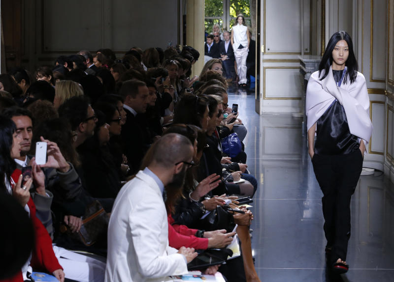 A model wears a creation by British fashion designer Phoebe Philo for Celine's Spring-Summer 2013 ready to wear collection, presented in Paris, Sunday, Sept.30, 2012. (AP Photo/Jacques Brinon)