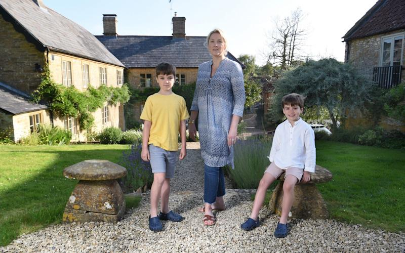 Estelle Lee at home in Somerset with her two sons, Alexander and Freddie, while her husband, Andrew, works in London - COPYRIGHT JAY WILLIAMS