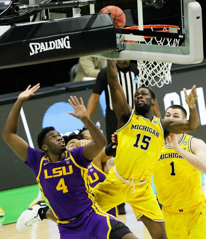 Michigan guard Chaundee Brown (15) puts up a shot against LSU Tigers forward Darius Days (4) during their second-round game.