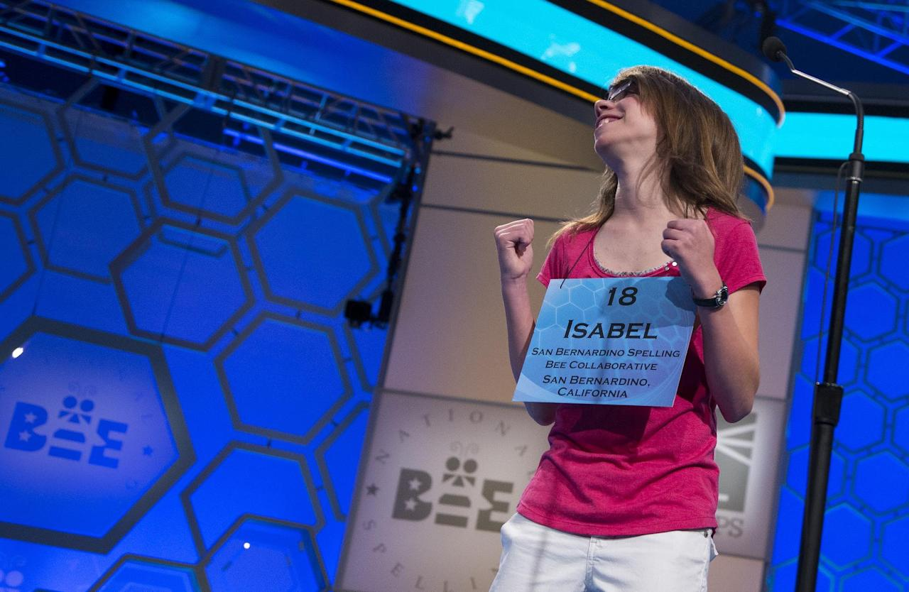 "Isabel Cholbi of San Bernardino, Calif., reacts after spelling the word ""telergy"" correctly during the semifinal round of the National Spelling Bee, Thursday, May 30, 2013, in Oxon Hill, Md. (AP Photo/Evan Vucci)"