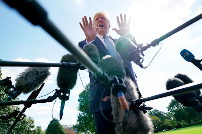 President Donald Trump talks to journalists on the South Lawn of the White House before boarding Marine One and traveling to Walter Reed National Military Medical Center October 04, 2019 in Washington, DC. (Chip Somodevilla/Getty Images)