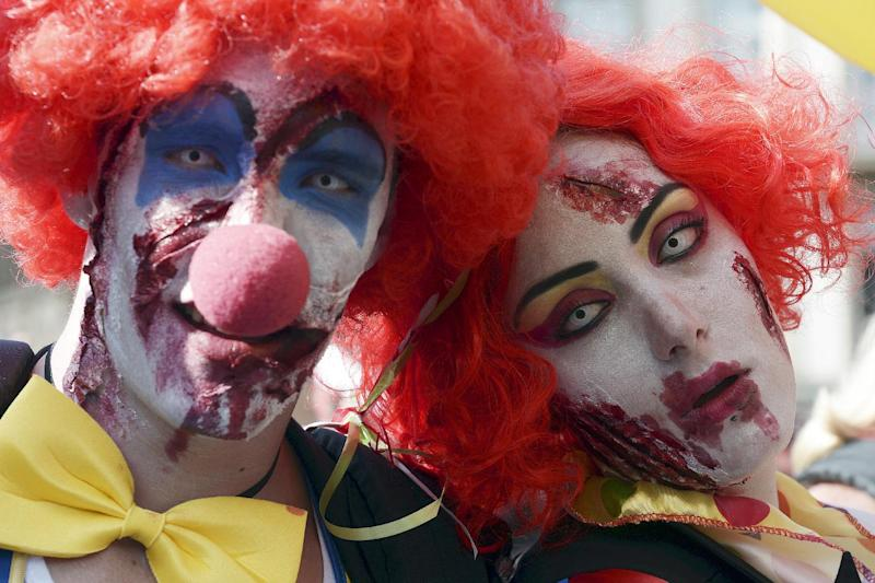 People dressed as zombie clowns take part in the Zombie Walk on September 13, 2014 in the eastern French city of Strasbourg