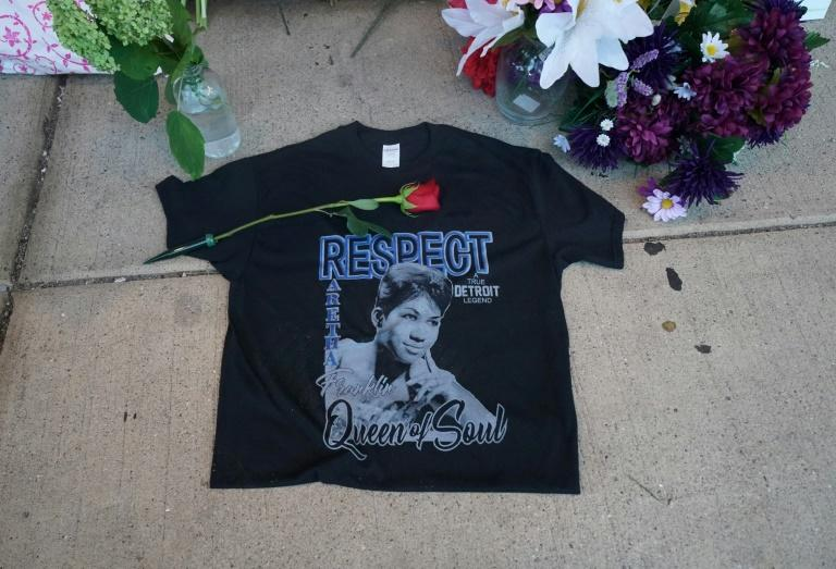 A rose is placed on a t-shirt at a temporary memorial set up for late singer Aretha Franklin at New Bethel Baptist Church in Detroit, Michigan