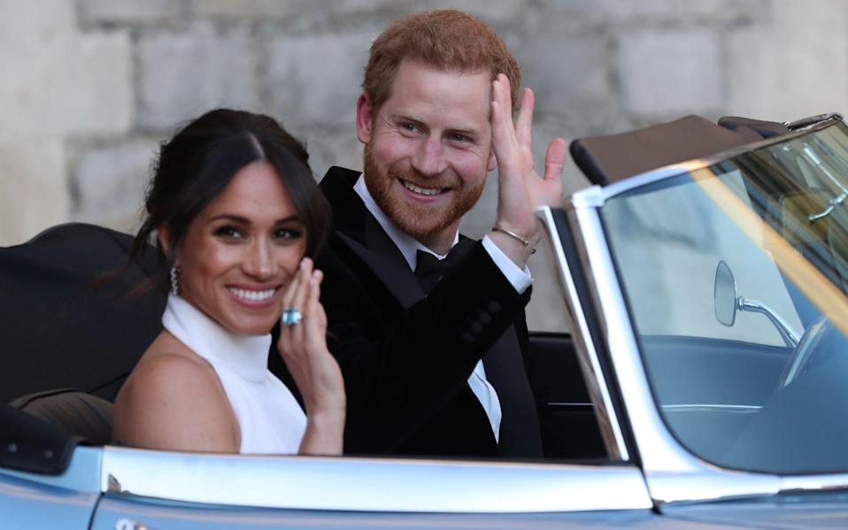 The Duke and Duchess of Sussex on their wedding day, 2018. The Duchess wears a ring that belonged to the late Princess Diana