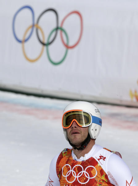 United States' Bode Miller looks up from the finish area after finishing the men's downhill at the Sochi 2014 Winter Olympics, Sunday, Feb. 9, 2014, in Krasnaya Polyana, Russia. (AP Photo/Gero Breloer)