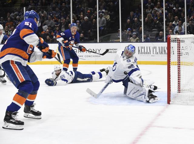 Tampa Bay Lightning goaltender Andrei Vasilevskiy (88) stops the puck as New York Islanders' Valtteri Filppula (51) and Lightning's Braydon Coburn (55) look for a rebound during the second period of an NHL hockey game Friday, Feb. 1, 2019, in Uniondale, N.Y. (AP Photo/Kathleen Malone-Van Dyke)