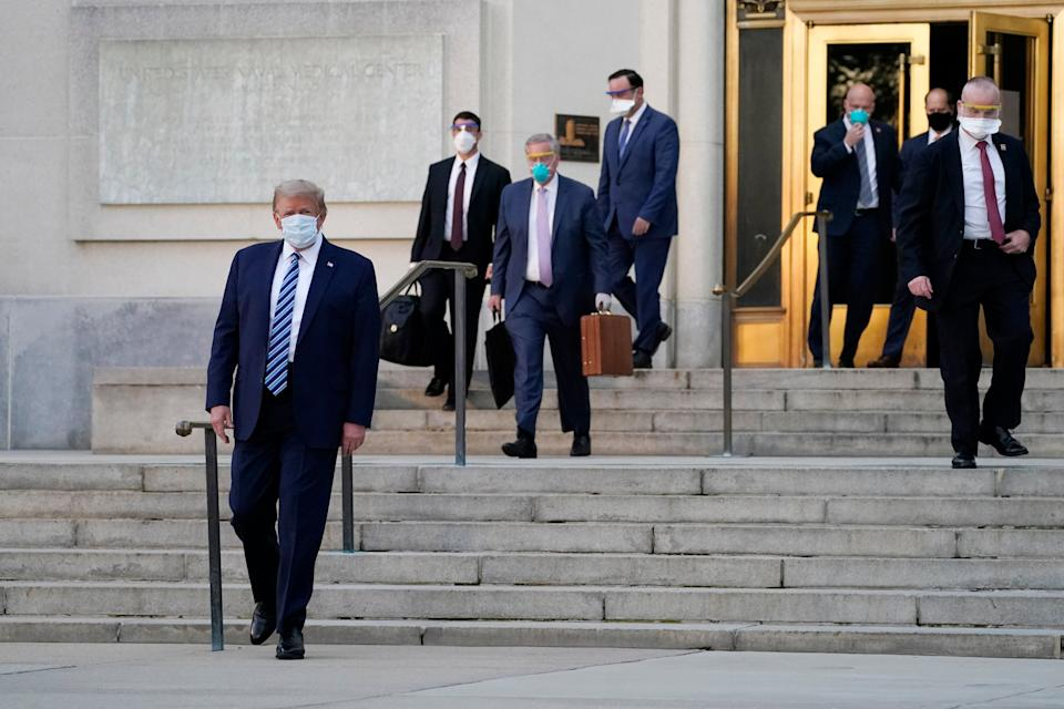 <p>Donald Trump walks out of Walter Reed medical centre following his hospitalisation from the coronavirus.</p>AP