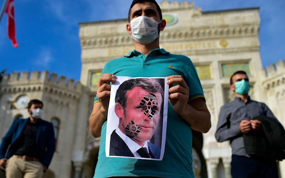 President Macron's decision to defend the showing of drawings of the Prophet Muhammad caused outrage across the Muslim world - YASIN AKGUL/AFP