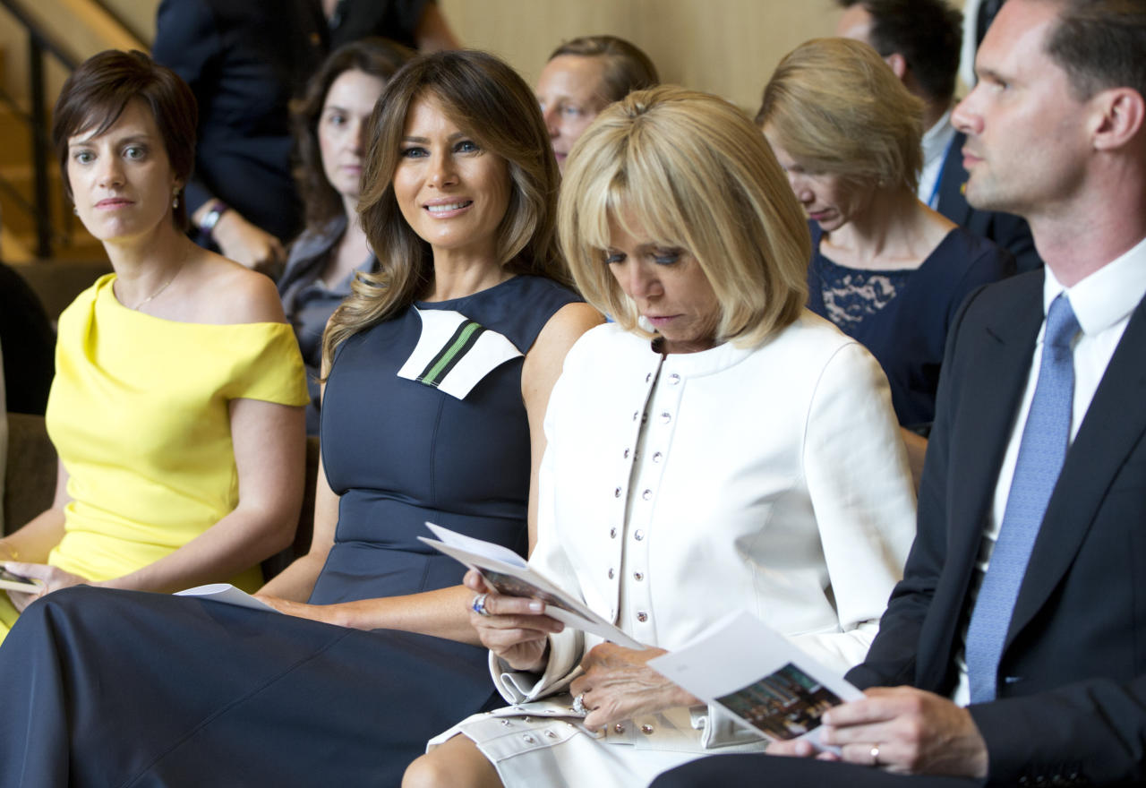 U.S. first lady Melania Trump, second left, prepares to listen to a concert at the Queen Elisabeth Music Chapel in Waterloo, Belgium, during a spouses program on the sidelines of the NATO summit on Wednesday, July 11, 2018. From left, Amelie Derbaudrenghien, the partner of Belgian Prime Minister Charles Michel. Brigitte Macron, the wife of French President Emmanuel Macron and Gauthier Destiny, the husband of Luxembourg's Prime Minister Xavier Bettel. (AP Photo/Virginia Mayo)
