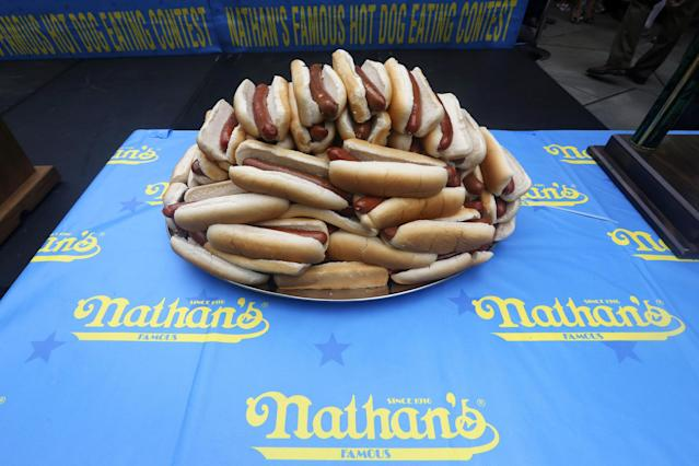 Hot dogs are on display during the official weigh-in for the Nathan's Fourth of July hot dog eating contest, Wednesday, July 3, 2013 at City Hall park in New York. (AP Photo/Mary Altaffer)
