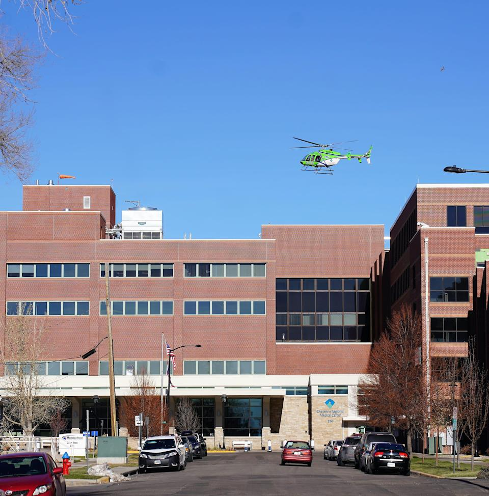 A medevac helicopter lands on the roof of the Cheyenne Regional Medical Center in downtown Cheyenne, Wyoming, on Nov. 16, 2020.
