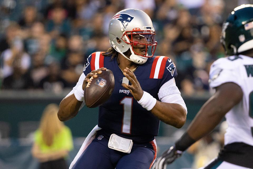 Patriots quarterback Cam Newton drops back to pass against the Eagles during the first quarter Thursday night.