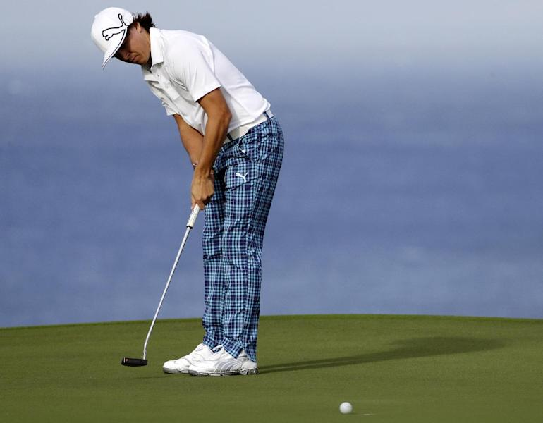 Rickie Fowler putts on the 10th hole during the first round at the Tournament of Champions PGA golf tournament, Monday, Jan. 7, 2013, in Kapalua, Hawaii. Fowler just missed on the shot. Play was to have started three days earlier, but was delayed because of rain and high winds. (AP Photo/Elaine Thompson)