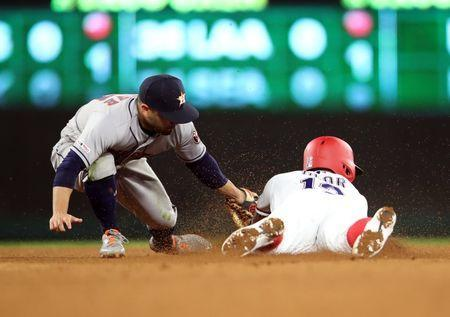 Apr 1, 2019; Arlington, TX, USA; Houston Astros second baseman Jose Altuve (27) tags out Texas Rangers second baseman Rougned Odor (12) trying to steal second base during the seventh inning at Globe Life Park in Arlington. Mandatory Credit: Kevin Jairaj-USA TODAY Sports
