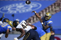 UCLA quarterback Dorian Thompson-Robinson, right, throws a pass during the second half of an NCAA college football game against California in Los Angeles, Sunday, Nov. 15, 2020. (AP Photo/Kelvin Kuo)