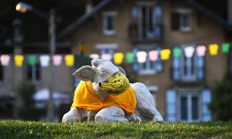 Cow statue sporting a yellow jersey during Stage 16 from La Tour-Du-Pin to Villard-De-Lans.