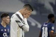 FILE - In this Tuesday, March 9, 2021 file photo Juventus' Cristiano Ronaldo reacts during the Champions League, round of 16, second leg, soccer match between Juventus and Porto in Turin, Italy. Neither Lionel Messi nor Cristiano Ronaldo will be in the Champions League quarterfinals for the first time since 2005. The two greatest players of the current generation were both eliminated from the competition this week. Messi scored a goal but missed a penalty as Barcelona was eliminated by Paris Saint-Germain. Ronaldo and his Juventus teammates were ousted by Porto the night before. Ronaldo has won five Champions League titles in his career. Messi has won four. (AP Photo/Luca Bruno, File)