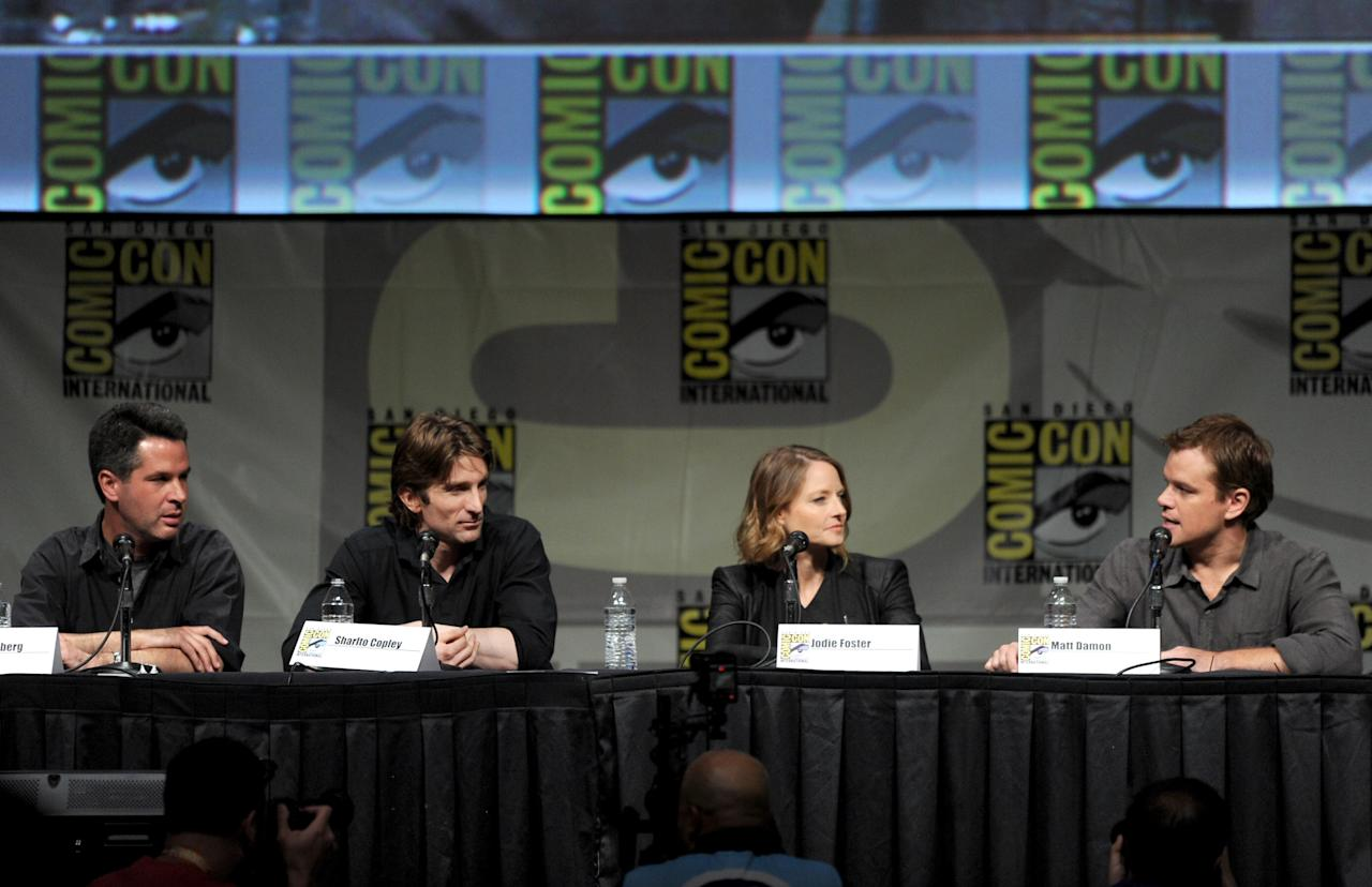 "SAN DIEGO, CA - JULY 13:  (L-R) Producer Simon Kinberg, actors Sharlto Copley, Jodie Foster, and Matt Damon speak during Sony's ""Elysium"" panel during Comic-Con International 2012 at San Diego Convention Center on July 13, 2012 in San Diego, California.  (Photo by Kevin Winter/Getty Images)"
