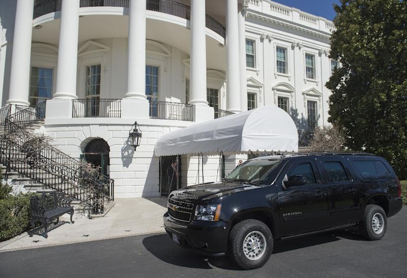 A SUV is parked outside of the South Portico on the South Lawn of the White House in Washington, DC, March 11, 2017 after a man carrying a backpack was arrested for breaching security