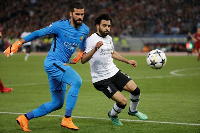 Soccer Football - Champions League Semi Final Second Leg - AS Roma v Liverpool - Stadio Olimpico, Rome, Italy - May 2, 2018 Liverpool's Mohamed Salah in action with Roma's Alisson Becker REUTERS/Max Rossi