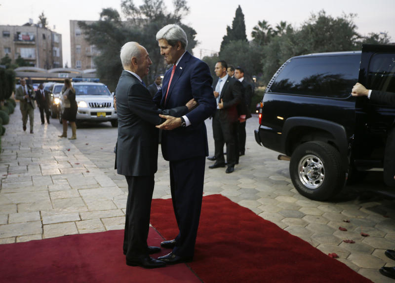 "U.S. Secretary of State John Kerry, right, is welcomed by Israel's President Shimon Peres in Jerusalem, Wednesday, Nov. 6, 2013. Kerry waded again into the nitty-gritty of faltering Israeli-Palestinian peace talks on Wednesday, saying he was optimistic that tensions and difficulties could be overcome, even between ""two proud people"" struggling to reach an accommodation.(AP Photo/Jason Reed, Pool)"