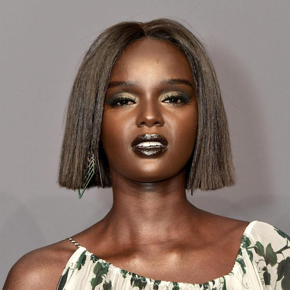 """Australian model Duckie Thot goes back and forth between long and short hair, but this jaw-dropping blunt bob continues to be a favorite. """"As DIY haircuts have become more common, many are opting for a big change, like cutting off most of the length,"""" says Marjan. """"A bob feels fresh, chic, and has time to grow out if it will be a while before you get a trim again."""""""