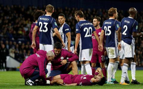 """Manchester City manager Pep Guardiola believes English clubs might be better without the """"wasted energy"""" of a League Cup campaign. The Spaniard echoed the view expressed by United counterpart Jose Mourinho on Wednesday, when the Portuguese suggested the domestic game could perhaps """"survive or even be better without this competition"""", which United won last season. Guardiola, like most managers, made major changes for the midweek cup win over West Brom and is poised to switch back to a first-choice XI for the visit of Crystal Palace in the Premier League on Saturday. There were eight alterations to the team sheet for the game against the Baggies compared to the team which thrashed Watford last weekend, with City facing a hectic schedule which includes games against Shakhtar Donetsk and Chelsea before the end of the month. """"Business is business, but we have a lot of games,"""" Guardiola said at a press conference on Friday ahead of the Palace match. City lost Ilkay Gundogan to injury on Wednesday Credit: Reuters """"If you have to play the competition you have to play the competition, but it is a title that when you win it is okay, but after that people don't give too much credit. """"You don't promote to go to international competitions. The prize is good when you win another one, but you waste a lot of energy. """"You can't imagine going to play Tony Pulis teams at West Bromwich Albion, play 90 minutes there in those conditions, and then after three or four hours - bus, come back, three days later Crystal Palace, three days later Shakhtar Donetsk, three or four days later Stamford Bridge. """"For the managers it is a lot of wasted energy, but we knew that before, so it is not a complaint in those terms. If we have to play we have to play."""" Which Premier League captains were born closest to their club? However, the League Cup remains """"very important"""" for teams like Stoke, according to their manager Mark Hughes. The Potters boss made six changes to his team for the trip to Bristol Ci"""