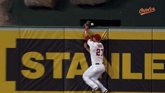 Mike Trout crashes into the wall, helps a homer over the fence