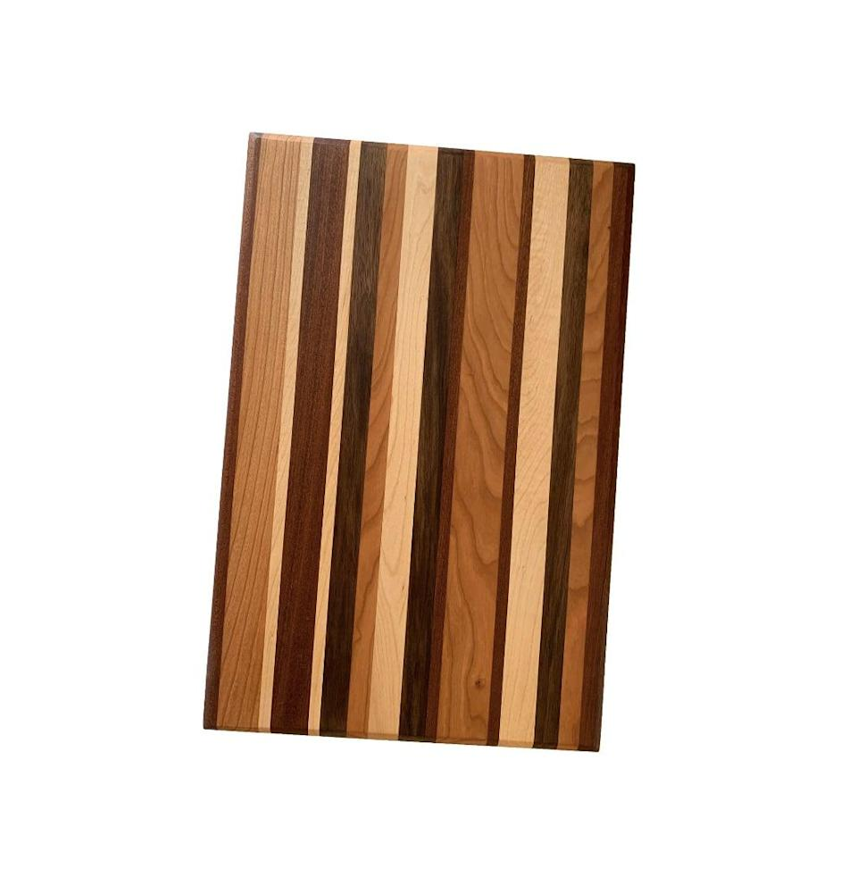 <p>We love the colorful stripes of this <span>Domain by Laura Hodges Studio Face Grain Cutting Board</span> ($33).</p>