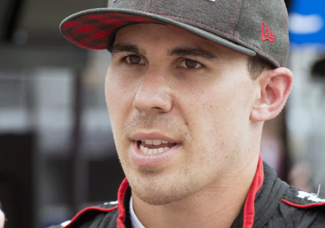 """FILE - In this July 13, 2018, file photo, Robert Wickens talks after the second practice session for the Toronto Indy IndyCar auto race in Toronto. Wickens is paralyzed from the waist down from injuries suffered in an August crash at Pocono Raceway. Wickens has been updating his rehabilitation progress on social media and posted a video Thursday of his """"first slide transfer as a paraplegic"""" that showed him moving from a table to his wheelchair. His videos had shown for the past month that he is working daily to move his legs again, but his Thursday, Oct. 25, 2018, post was the first time he publicly confirmed paralysis. (Frank Gunn/The Canadian Press via AP, File)"""