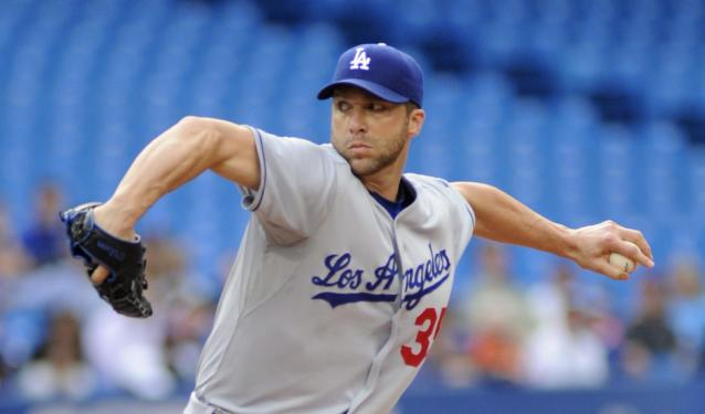 Los Angeles Dodgers' Chris Capuano pitches against the Toronto Blue Jays of a baseball game Tuesday, July 23, 2013, in Toronto. (AP Photo/The Canadian Press, Jon Blacker)
